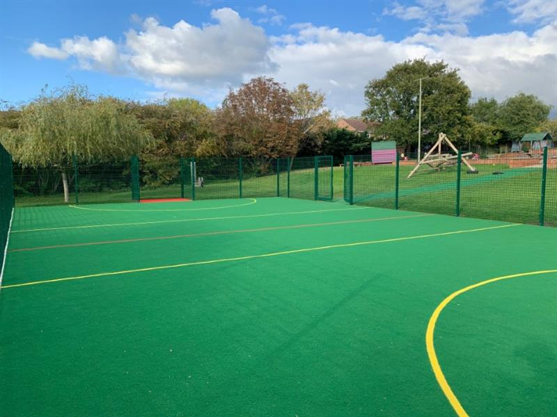 the inside of a 3g muga pitch showing in cut sport lines