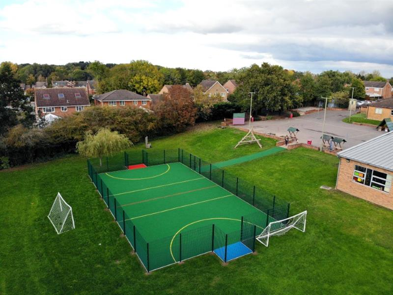 An aerial shot of a muga pitch installed onto a school field