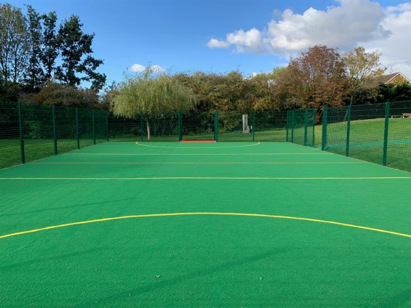 A muga with in cut sport lines and recessed goal ends