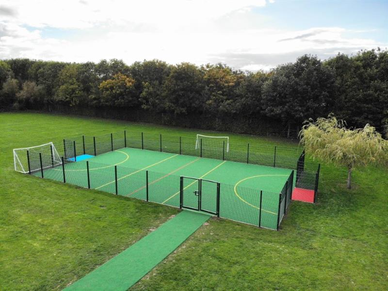 A multi use games area installed onto a school field