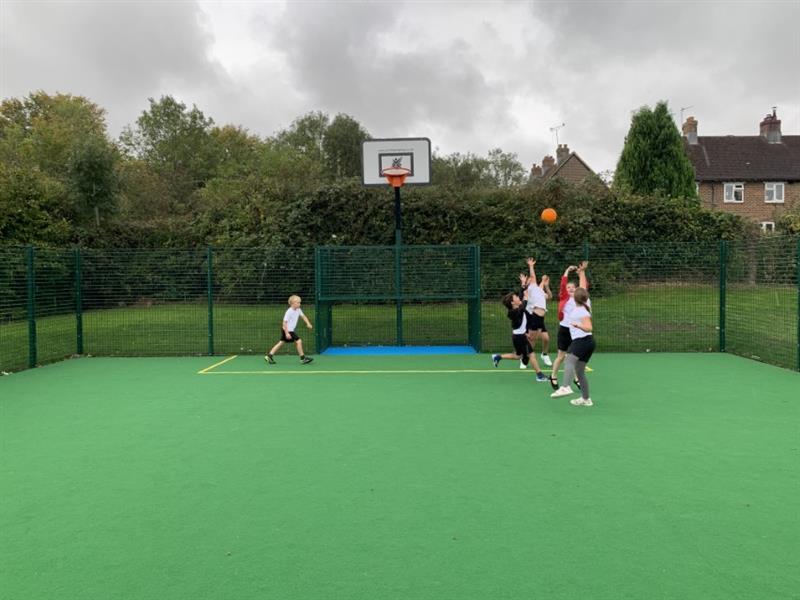 Children playing basketball on Pentagon Play's new MUGA pitch