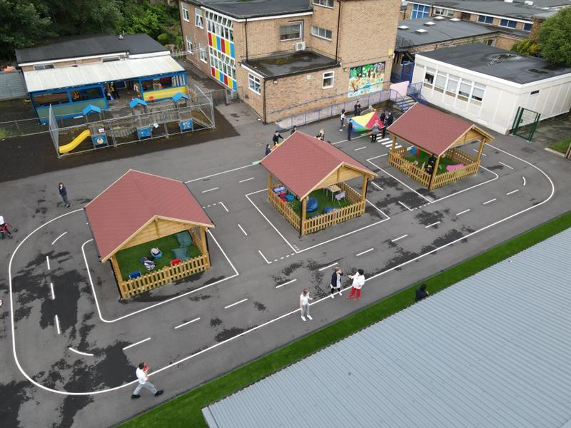 A birds eye view of the whole playground a Corbets Tey Primary School, there are 3 of our outdoor classroom and a roadway surrounding them.