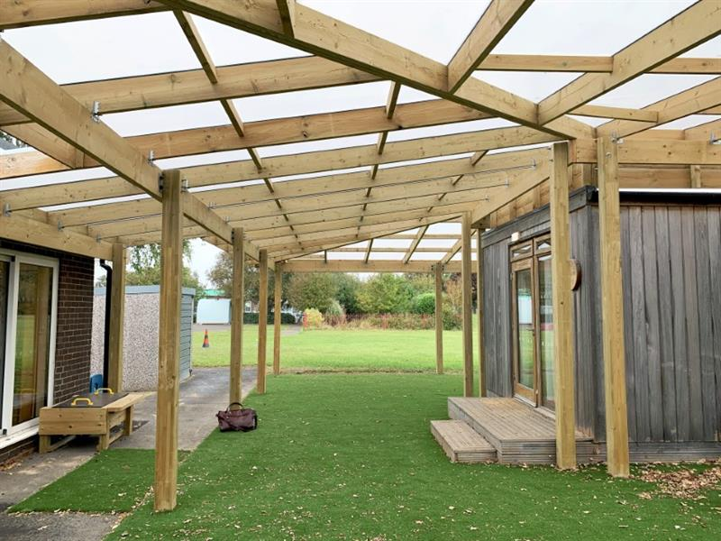 A timber canopy installed in a school playground