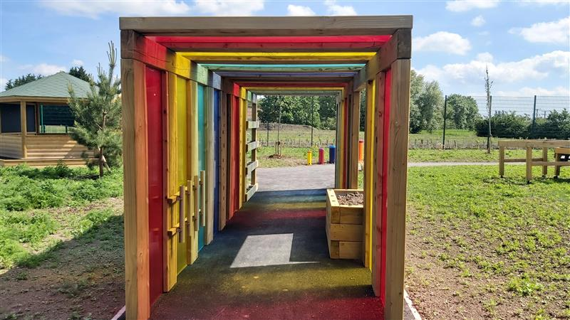 A front view photo of the rainbow sensory tunnel
