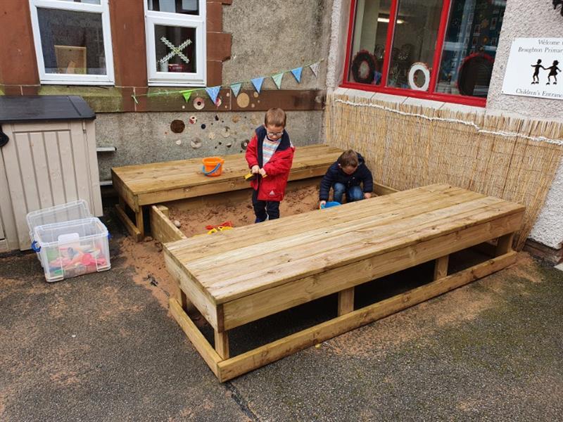 Children digging in a sand box