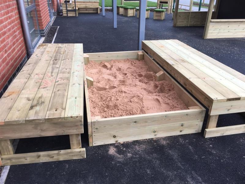 A covered sand box with the lid open
