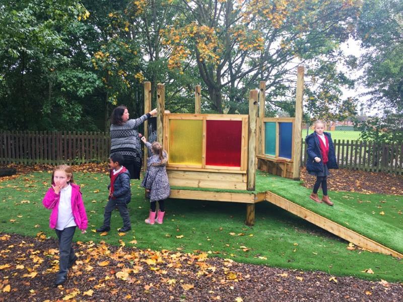 Children running around an imagination station
