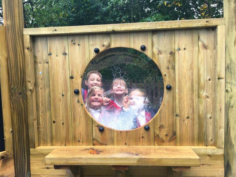 Children looking through a bubble window in a imagination station