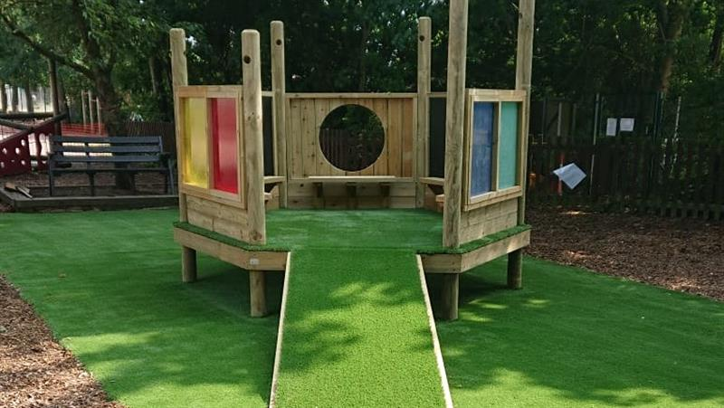 An imagination station installed on artificial grass surfacing