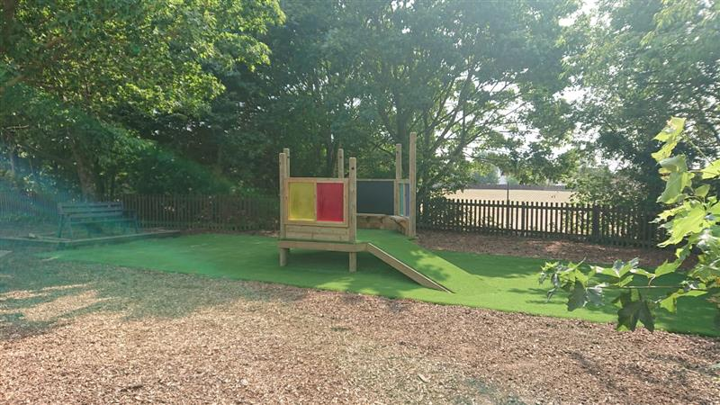 An imagination station installed on top of artificial grass surfacing