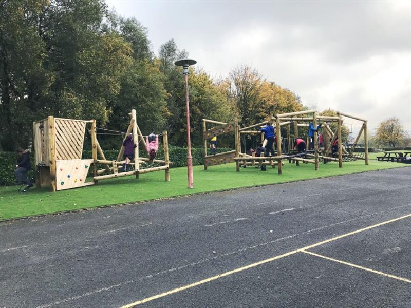 Children climbing on playground climbing frames