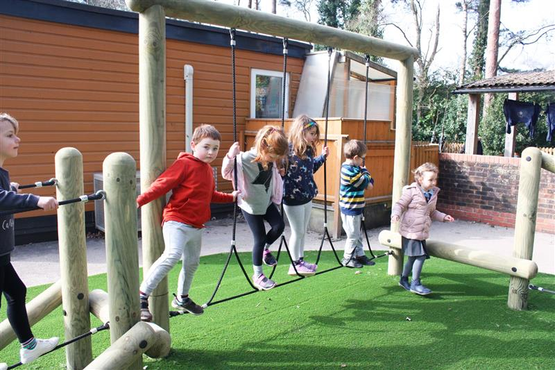 children moving through the many obstacles featured on a forest trim trail