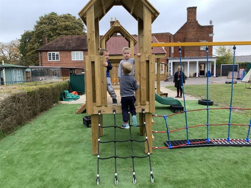 Toddlers climbing and playing on a play tower