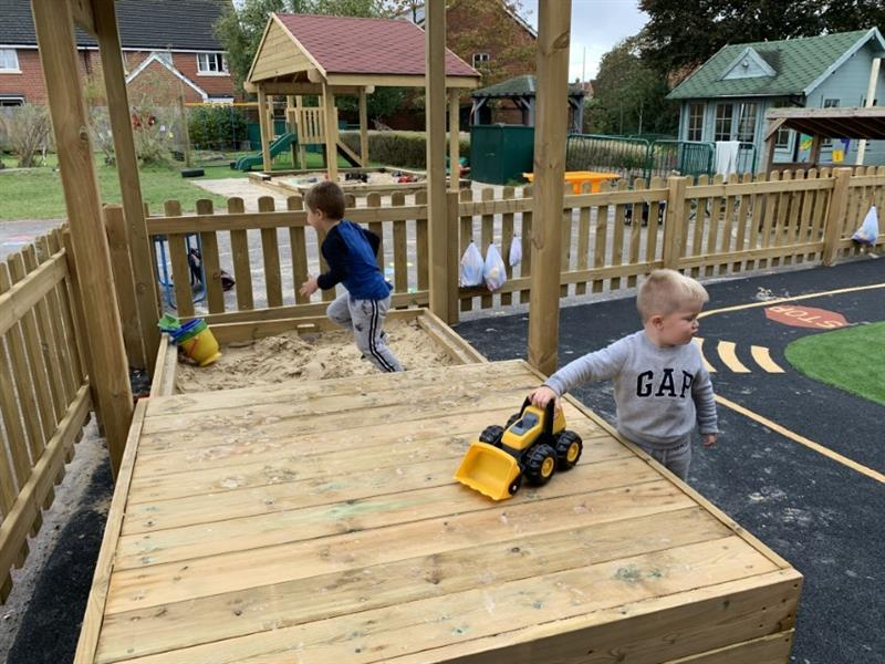 Toddlers playing in a sand pit