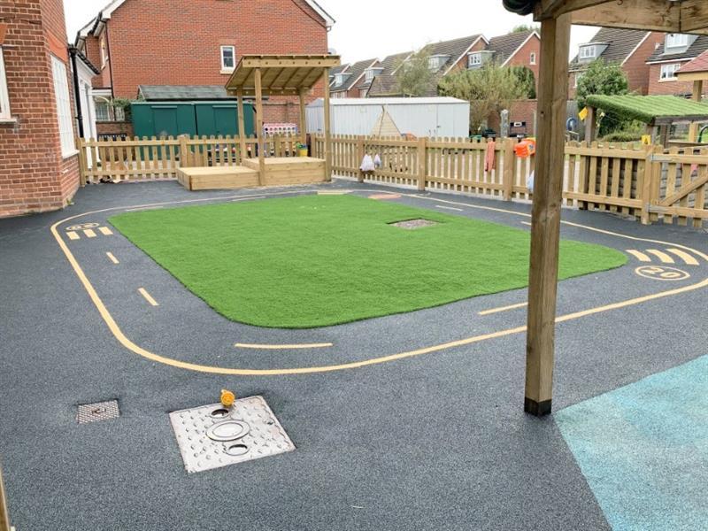 A life like black wetpour roadway in a nursery garden