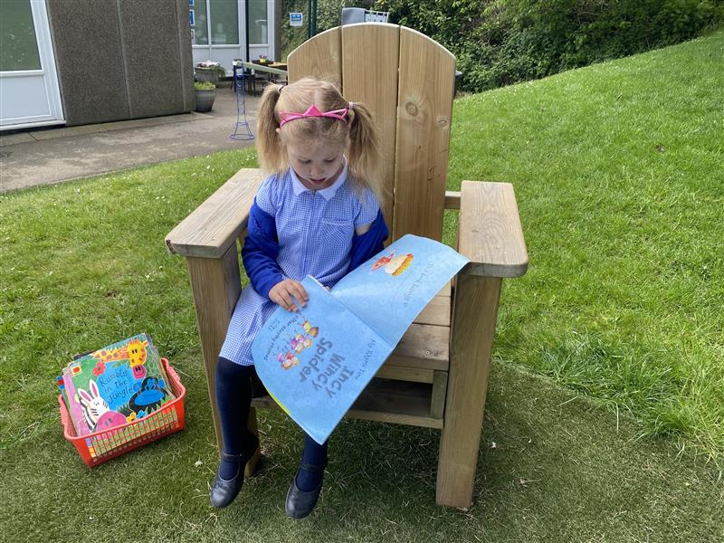 story telling chair with a young girl sat on it