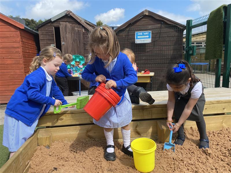children playing in our sandbox