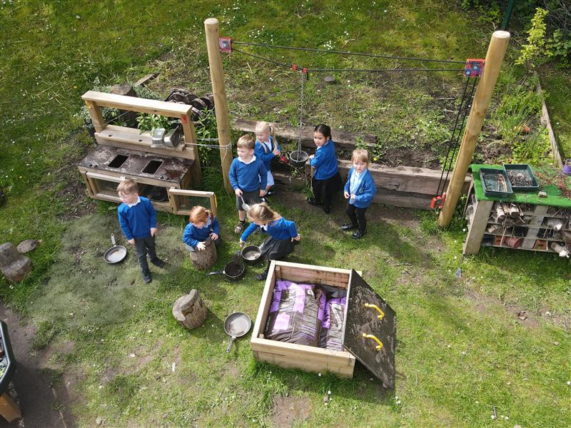 children playing in our mud kitchen area