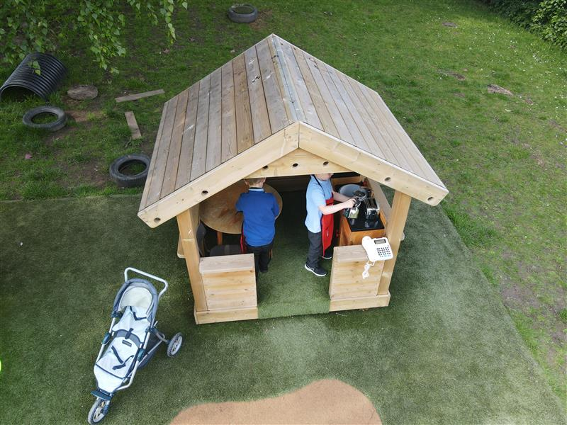 children playing in our playhouse