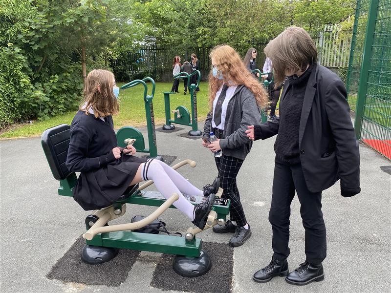 childrne playing on the gym equipment at darwen school