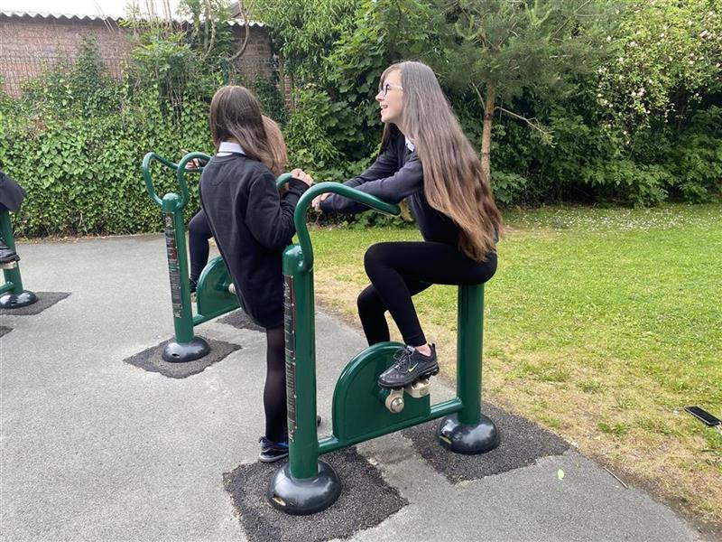 a girl using the outdoor gym