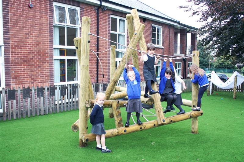 EYFS children climbing on a climbing frame