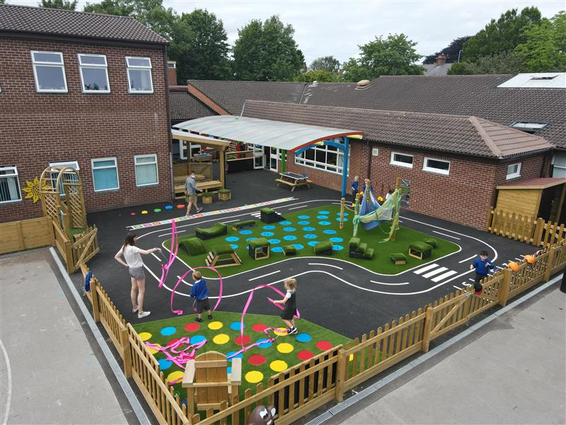 eyfs children playing in the eyfs play area