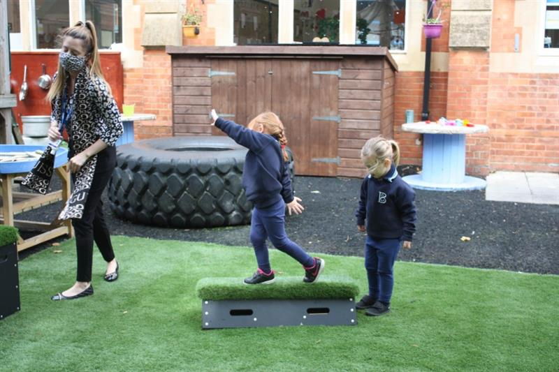 Child balancing on a get set go block balance block in the playground