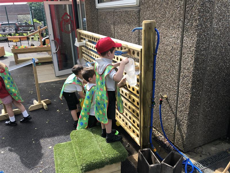 a side view of children playing on our water wall