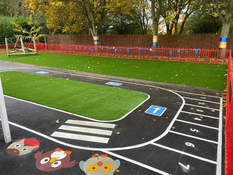 Thermoplastic playground markings installed as a realistic roadway on the playground