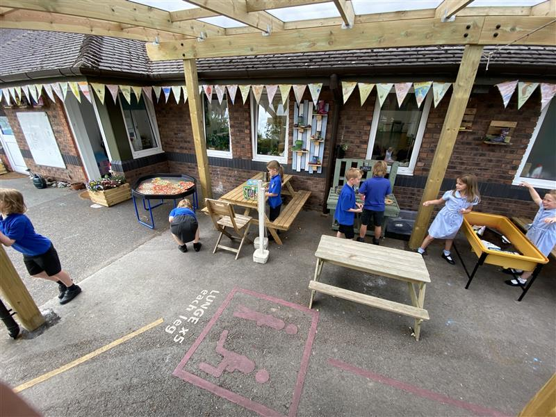 A picture of children under our canopy