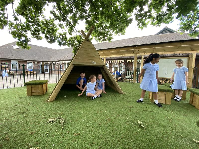 children playing in our wigwams and grass top seats