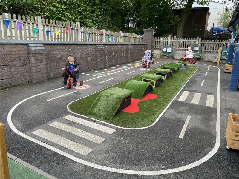 children riding bikes on roadway markings