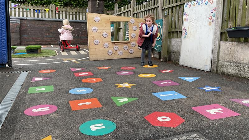 children playing on the alphabetical playground markings
