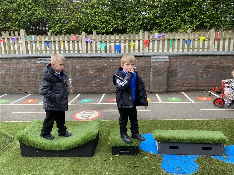 two young boys playing on our get set, go! blocks