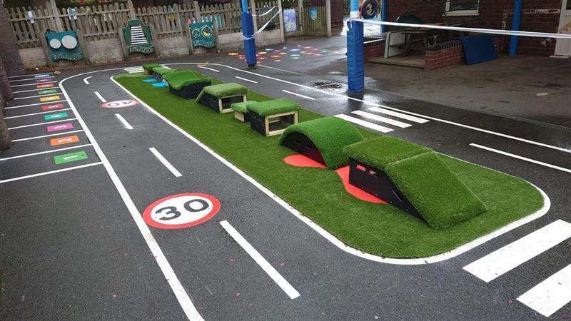 a picture of the whole playground with roadway in it