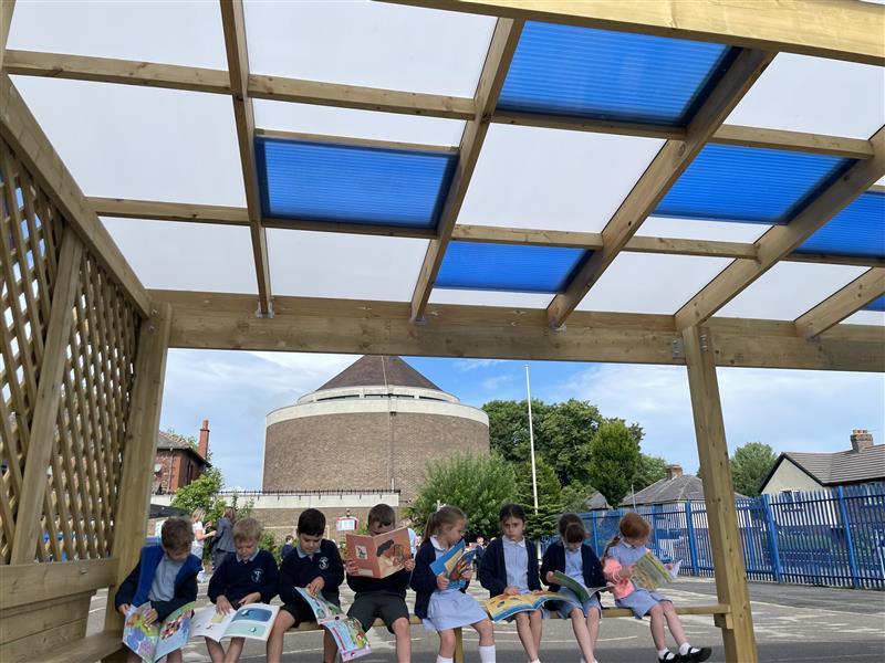 children sat underneath their new canopy