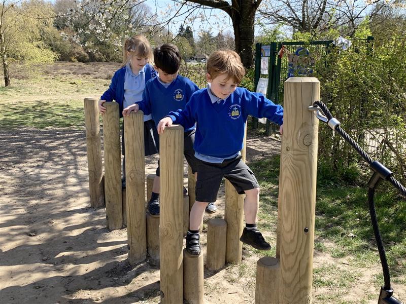 3 children tackling a set of trim trail walk and stretch