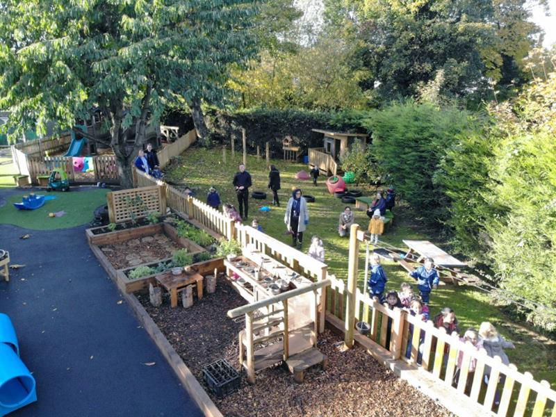 Toddlers playing in a nursery garden