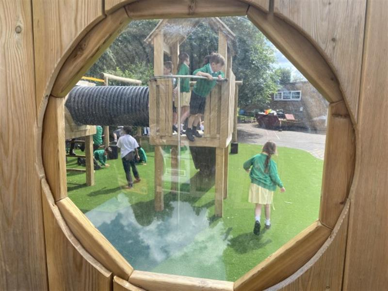 A photo of the view through a bubble window of a play tower