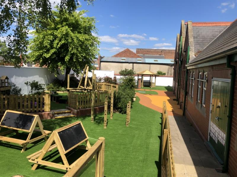 a huge selection of pentagon play eyfs products in the playground at Rawmarsh including easle tables, den making posts and a climbing frame