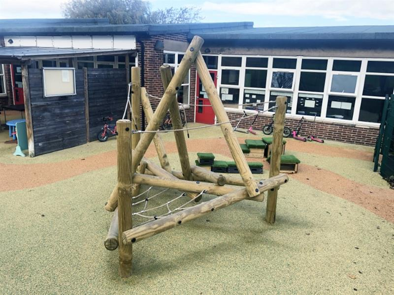 A climbing frame installed onto wet pour playground surfacing