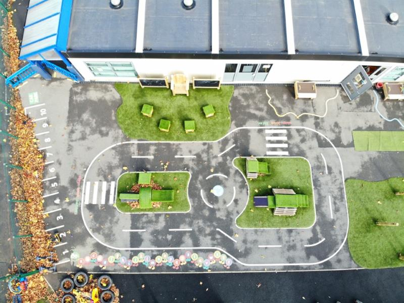 Realistic playground roadway made up of thermoplastic playground markings