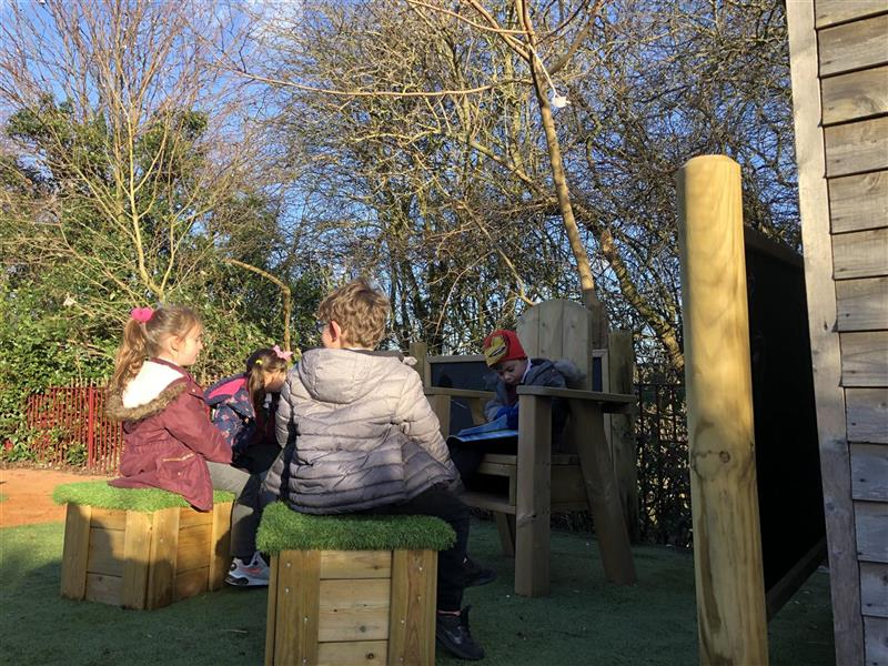 Children sat reading on our Free Standing Story Telling Chair