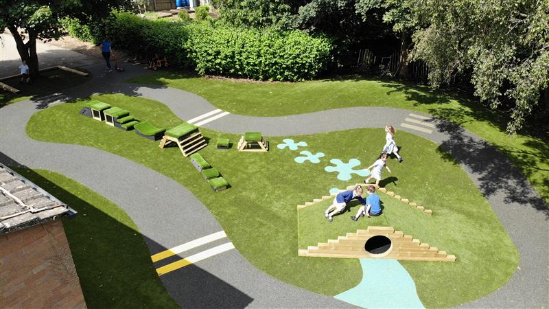 children playing on the artificial grass area
