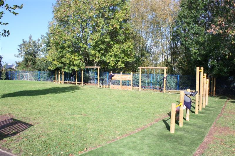 trim trail equipment installed onto artificial grass surfacing