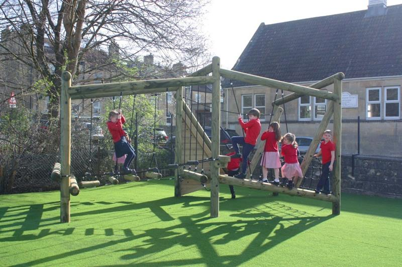 10 children playing on pentagon plays puzzlewood forest circuit climbing frame