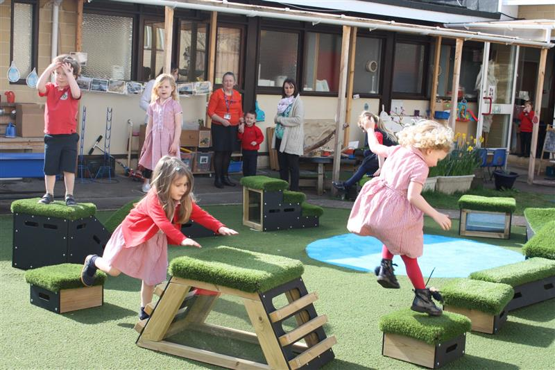 children stepping, climbing and balancing from one get set go block to another