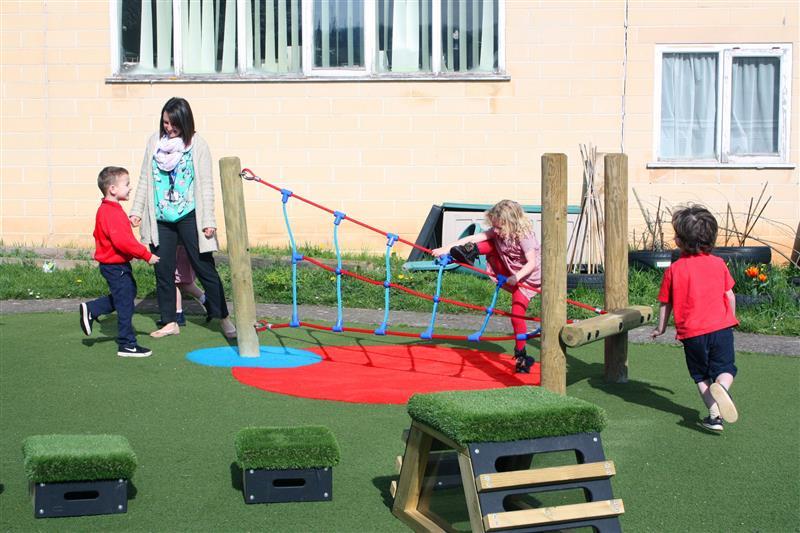 eyfs children climbing on a pentagon play twist net
