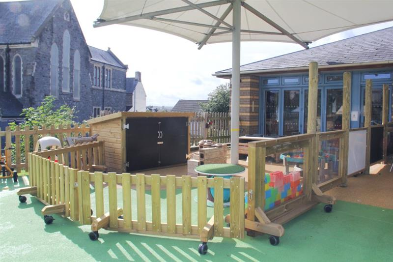 Interactive playground fencing zoning off a eyfs outdoor messy play space